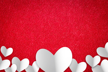 Valentine's day abstract background with cut paper heart on red carpet.