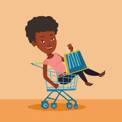 Happy woman riding by shopping trolley.