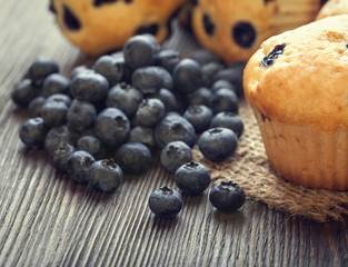 muffin with blueberries on a wooden table. fresh berries and swe