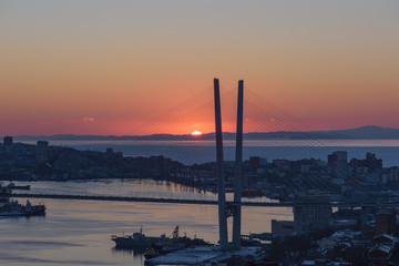 Vladivostok cityscape - sunset over bridge.