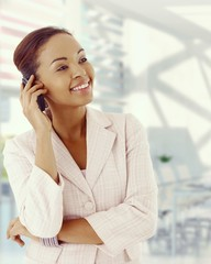 Attractive afro american businesswoman with phone