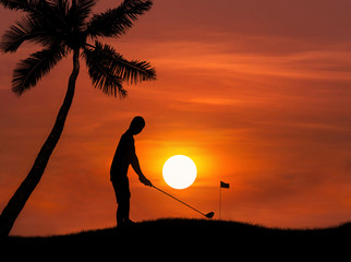 silhouette golfer hitting golf shot on sunset with palm trees