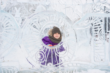 Boy hiding behind an ice sculpture