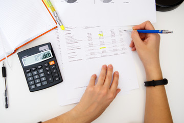 Woman prepares accounts at table