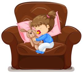 Kid sleeping on armchair