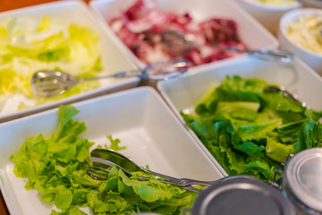 Salads on buffet table at restaurant .
