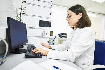 Researcher analyzing liquid chromatography data