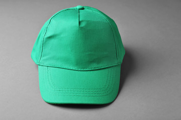 Blank green baseball cap on grey background