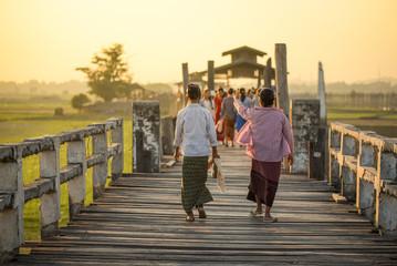 Burmese woman walk on U Bein Bridge, Myanmar