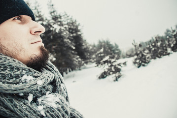 Portrait of a young handsome man with a beard. winter lifestyle