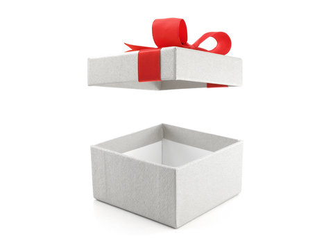 close up open empty gray gift box with red ribbon bow (lid is floating in the air) isolated on white background, square cardboard box wrapped in grey paper with bow for put presents in holiday festive