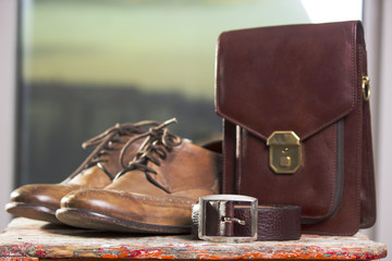 Retro shoes and leather purse with a leather belt.