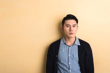 sad Asian young man