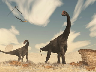 Brontomerus dinosaurs in the desert - 3D render