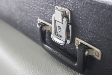 steel lock,Silver metal lock on a black suitcase