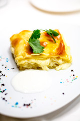 Cake of puff pastry with cheese.