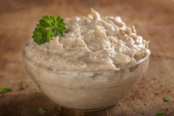 Bowl filled with cream made by tuna fish, butter and onion over