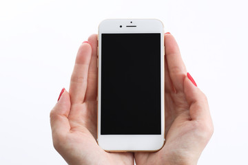 Female hands holding white smartphone
