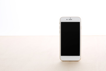 white smart phone on wooden table