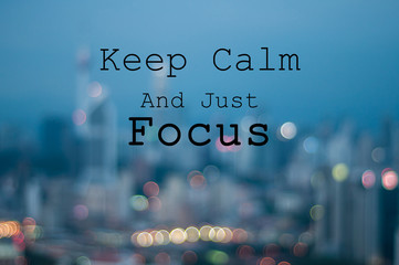 Keep Calm and Just Focus on blur city background