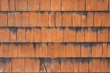 Wooden tiles country house facade surface closeup as background