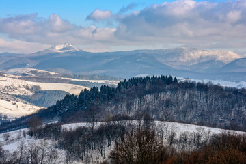 rural area in winter mountains