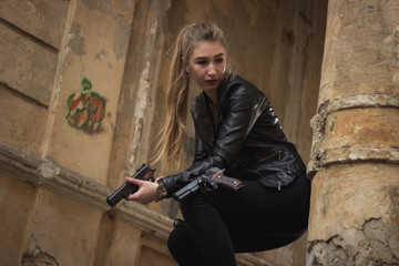 Powerful Woman Holding Gun Action Movie Style - Portrait of a girl in a heroine cosplay accessorized costume