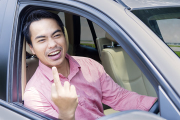 Angry businessman shows middle finger