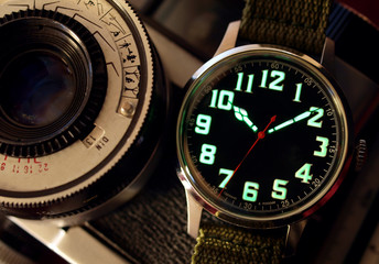 vintage black  watch close up over vintage camera