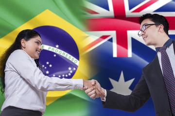 Brazilian woman shaking hands with Australian person