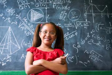 Portrait Happy Girl Resolving Complex Math Problem On Blackboard