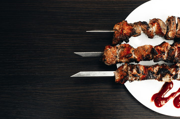 shish kebab on white plate