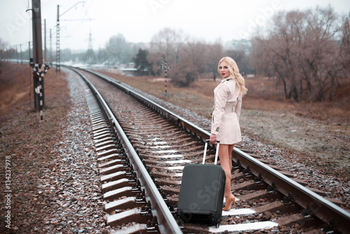 young fashion girl with suitcase at railways stockfotos. Black Bedroom Furniture Sets. Home Design Ideas
