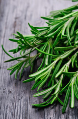fresh branches of rosemary on an old wooden background