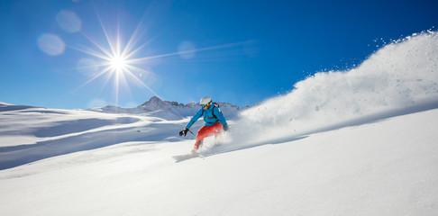 Freerider snowboarder running downhill