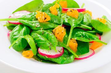 fresh salad with spinach, radish and orange