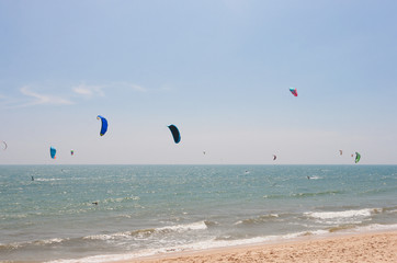 Unidentified people involved in kitesurfing