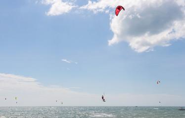 Kitesurfer jumping on beautiful background