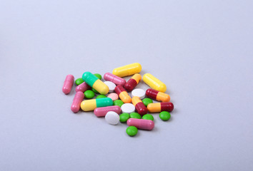 Pills and medical thermometer on white background. .