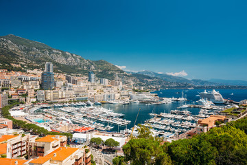 Monaco, Monte Carlo cityscape. Real estate architecture on mountain hill background