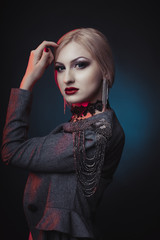 Fashionable woman with bright makeup and dressed in jacket