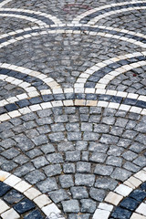old city cobblestone pavement with a geometric pattern of stones of different colors
