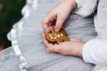 Girl holding a gingerbread man cookie