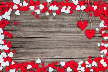 Valentines Day background Red and white hearts on wooden background. Top view, copy space