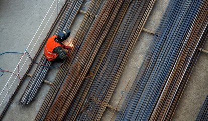 High angle view of a welder on a construction site.