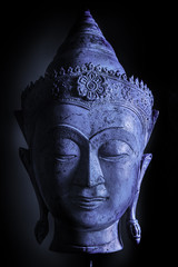 Calm cool buddha head. Blue tone accentuating the chilled relaxed feel of this spiritual image.