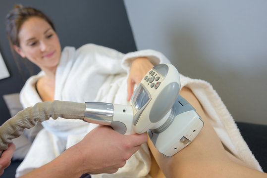 woman getting laser treatment on her legs