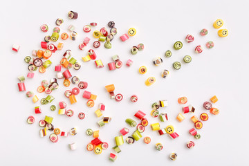 lollipops, candy pattern, top view flat lay on colorful background