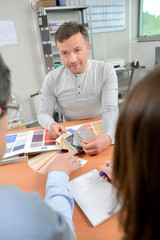 Interior designer showing color samples
