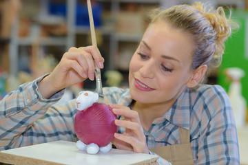 artist painting a figurine
